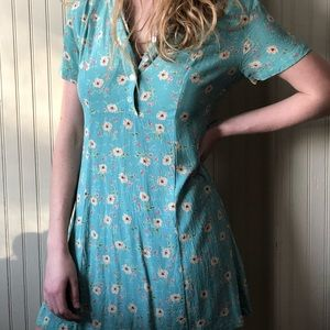 a cute teal summer dress with pink flowers